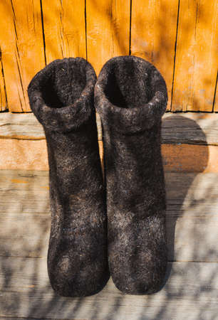 knee boots: rural old felt boots standing on a porch