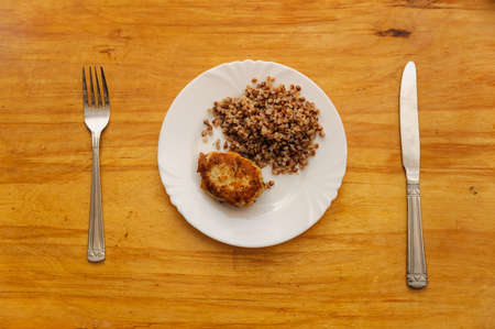 frugal: economy food. rissole and buckwheat groats Stock Photo