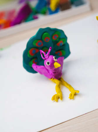 modelling: handmade toy of modelling clay. peacock bird Stock Photo