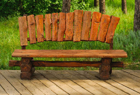 timber bench seat: handmade wood bench in green park