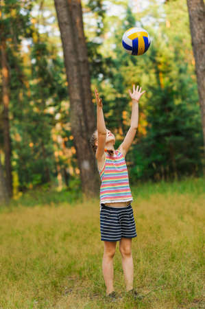 girl throwing a ball on nature backgrounds