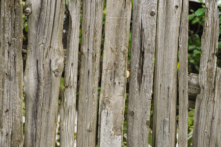 unfreedom: Old shabby wooden fence. Rural abstract backgrounds Stock Photo