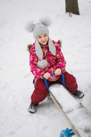 smile girl sitting on teeter-totter Stock Photo
