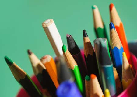 many multicolored pencils in a box. Selective focus technique