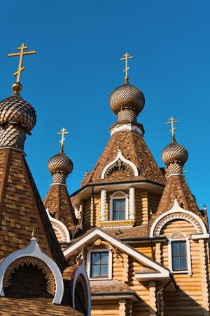 old orthodox wooden church on blue sky backgrounds