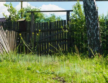 old rural wooden gate near freshness green grass
