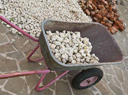 laden pram of many small stones