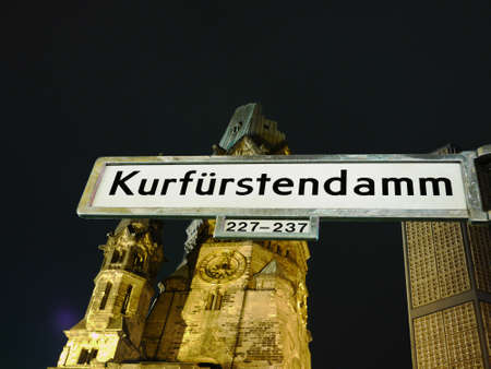 Berlin, The Kaiser Wilhelm Memorial Church by night, in front of it the street sign of Berlins most famous street, Berlin, die Kaiser-Wilhelm-Ged�chtniskirche am Kurf�rstendamm, im Vordergrund das Sta�enschild von Berlins Flaniermeile