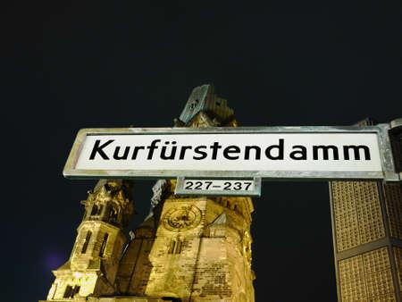 Berlin, The Kaiser Wilhelm Memorial Church by night, in front of it the street sign of Berlins most famous street, Berlin, die Kaiser-Wilhelm-Gedächtniskirche am Kurfürstendamm, im Vordergrund das Staßenschild von Berlins Flaniermeile Editöryel