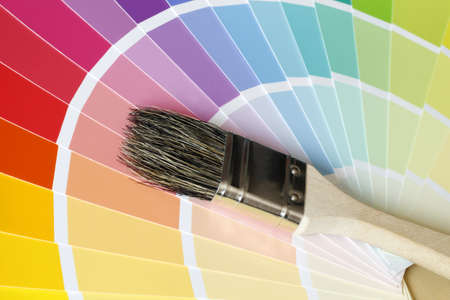a brush lies on color tables