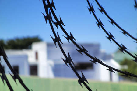 strong and dangerous barbed wire, used to protect the house and property to avoid thiefes Stock Photo - 18716534