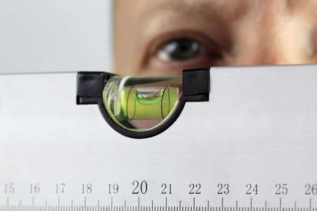 precise: male checks spirit level - ensure precise measurment