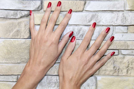 woman shows some pretty well manicured hands