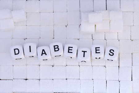 sugar cubes under letter cubes that form the word diabetes from top