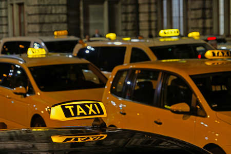 Lot of taxi cars waiting for their passengers in front of the main train station in Nuremberg, Germany