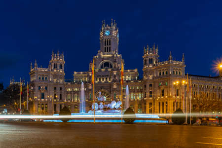 Madrid - Plaza de Cibeles with fountain and figure of Goddess Cibele and their lion driven cart, behind Palacio de Cibeles, post office and seat of the administration