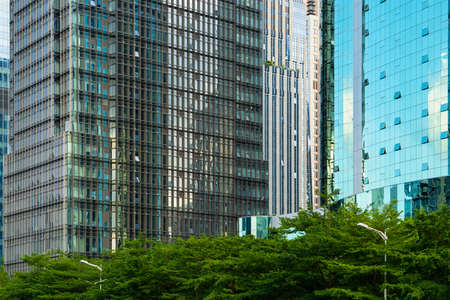 Shenzhen, China - financial district - Futian - some giant glass facade of several skyscrapers side by side Stok Fotoğraf