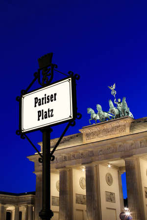 The traffic sign Pariser Place in Berlin with monument Brandenburger Tor in the background.