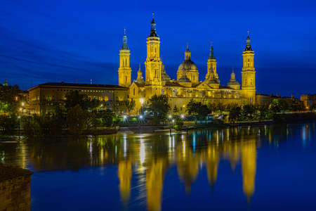 Cathedral, Basilca El Pilar, in Zaragoza, Aragon, Spain, Europe at blue hour with river Ebro in the front, done with long time exposure Stok Fotoğraf