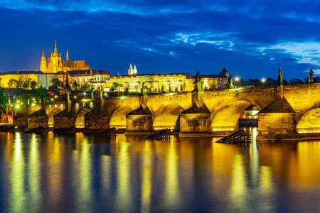 Prag, Czech Republic, the central bridge Karluv Most, built in the 14th century over the river Moldau at blue hour at Night Stok Fotoğraf