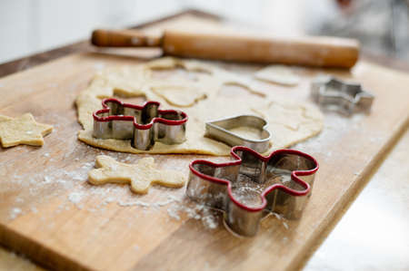 Still life, subject shooting of dough for Christmas gingerbread with the forms for cutting. Stock Photo