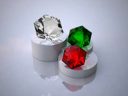 Diamond, ruby and emerald on a white background