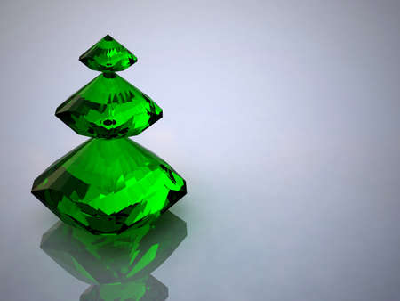 Diamond and emerald on a white background photo