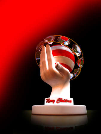 Figurine of a hand with a Christmas sphere Stock Photo - 10162436