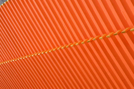 regimented: Repeating orange sections of a roof of a Japanese temple Stock Photo