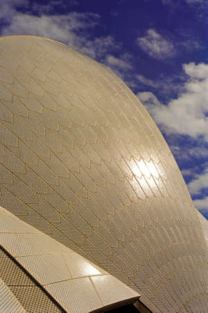 utzon: Sail-like curved roof of Sydney Opera House against a deep blue sky Stock Photo