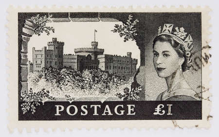 queen elizabeth: One pound stamp from 1955 depicting Windsor Castle and Queen Elizabeths portrait