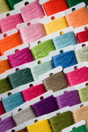 nylon string: A selection of brightly coloured cotton threads on bobbins Stock Photo