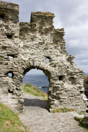 crumbling: Arch in an ancient crumbling wall