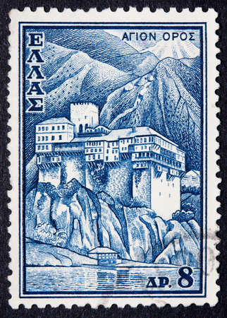 cancellation: Greece - Circa 1970: A postmarked stamp showing a building in the mountains