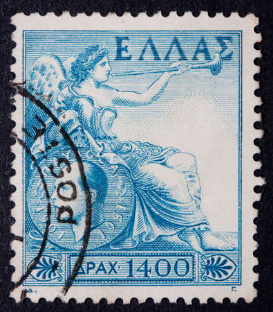 cancellation: Greece - Circa 1970: A postmarked stamp showing a reclining woman with a trumpet