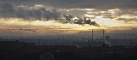 relentless: Smoke billowing over a dark industrial landscape