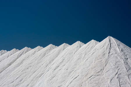 mounds: Mountains of salt at Santa Pola, Spain, obtained from the evaporation of sea water
