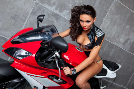 Sexy girl  with perfect body on red sportbike