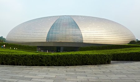 public houses: BEIJING, CHINA - SEPTEMBER 19, 2011: The National Center for the Performing Arts  is a titanium and glass shell which houses the public space.