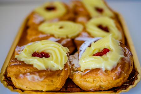 zeppole: Verticall tray of authentic traditional Neapolitan pastries: fried donuts