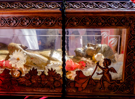 viacrucis: wooden statue of Christ in a coffin During The Way of the Cross in a town in southern Italy