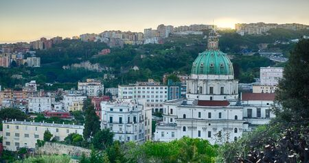 buon: Sunrise on The Buon Consiglio church in Naples, imitation of St. Peter in the Vatican. In backgroud the Vomero Hill