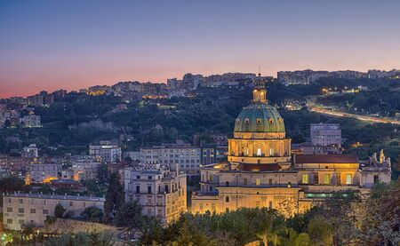 st  peter: Sunset on The Buon Consiglio church in Naples, imitation of St. Peter in the Vatican. In backgroud the Vomero Hill Stock Photo