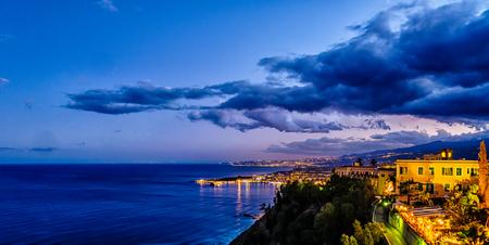 taormina: Taormina cloudy mediterranean sunset. Ionian sea, Sicily, Italy Stock Photo