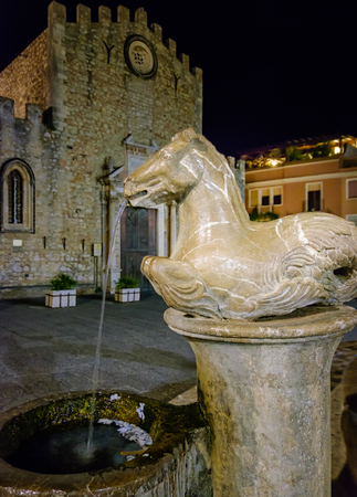 Horse fountain in an Taormina square. Sicily, Italy