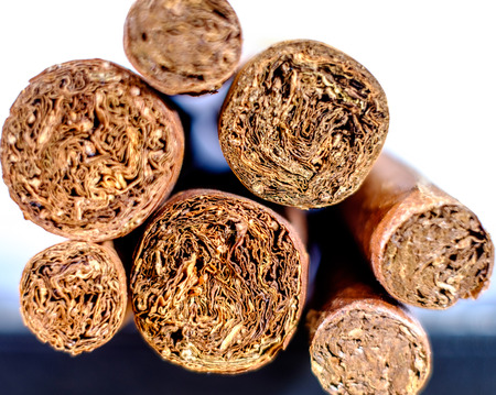 Feet of Cuban cigars. hand-rolled tobacco leaves