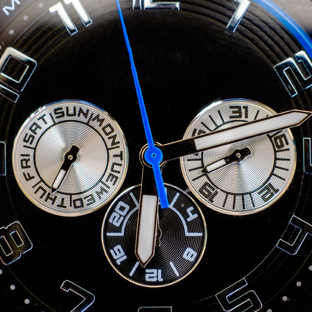 black clock hands: wristwatch closeup