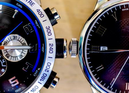 two wristwatches on wooden background Reklamní fotografie
