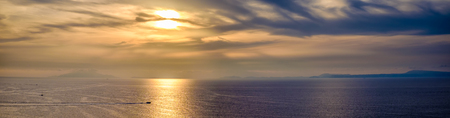 golden sunset on the sea of the Gulf of Sorrento. Campania, Italy