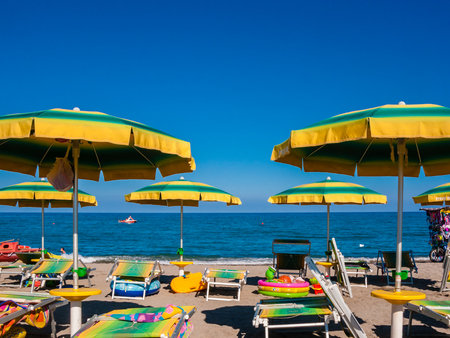The sea and the blue sky from a beach with umbrellas and sunbeds. Ionian Sea, Calabria. Italy Reklamní fotografie